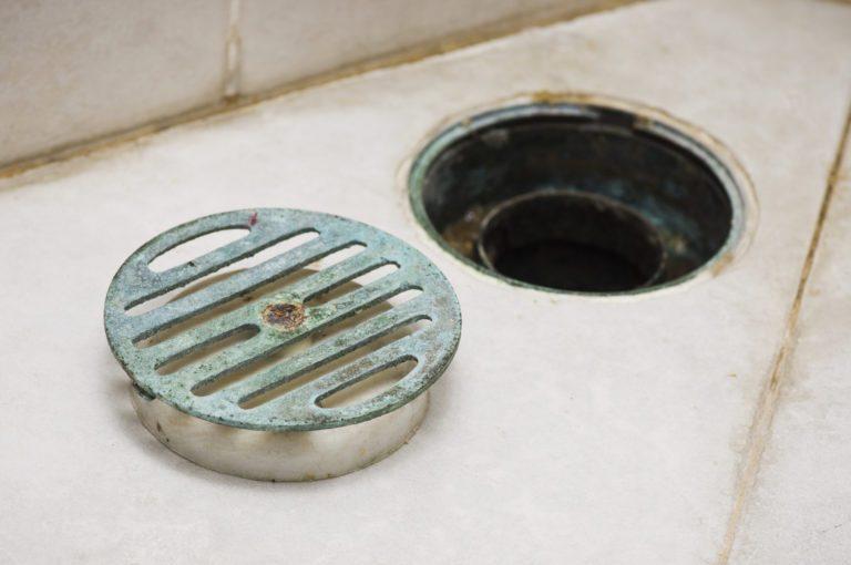 blue green stuff around tub drain